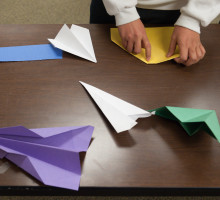 Individual folding multicolored paper airplanes